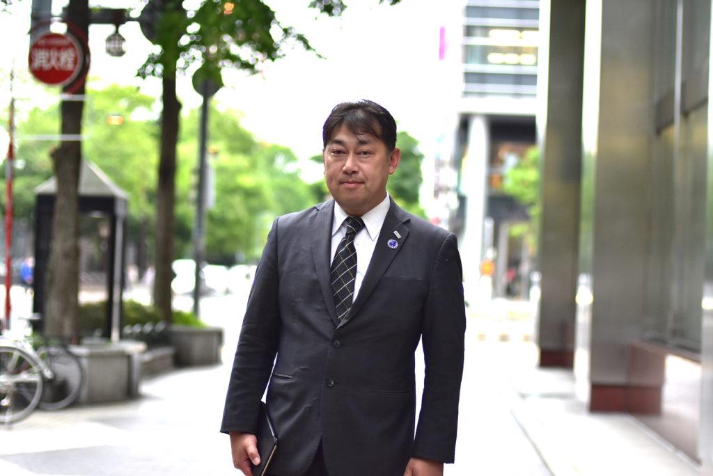 札幌の街中で伊藤正光さん